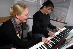 Beth Schuld, left, gives piano lessons to inmate Teresa van Wijk. Schuld says the enthusiasm shown by her Edmonton Institution students is 'like utopia for a music teacher.' Photograph by: Bruce Edwards, edmontonjournal.com